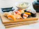 Salmon tuna shell shrimp and other meat sushi maki on wood tray with sauce and soup - Japanese food style